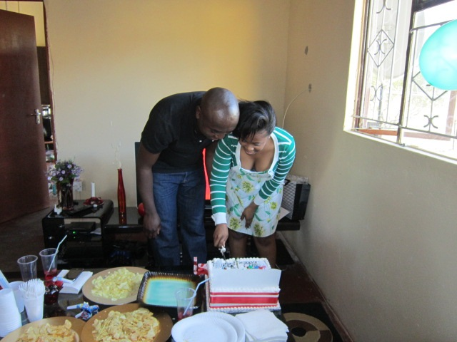 Lawrence and Chenai cutting the birthday cake