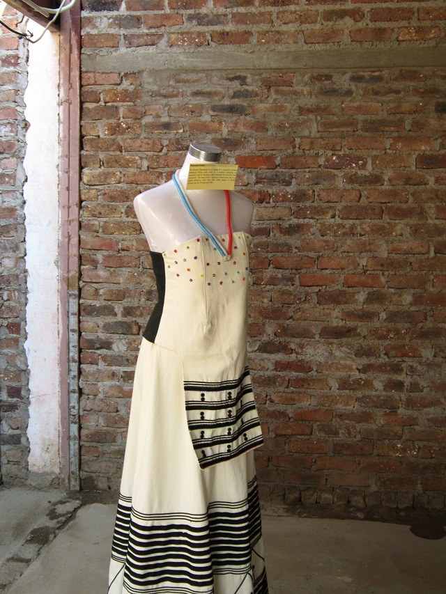 A very modern dress with traditional beadwork and button work