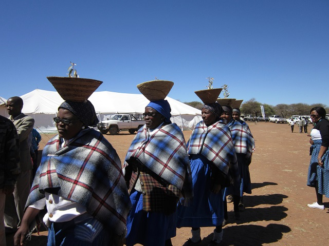 The ladies dressed in their traditional outfits preparing to begin the Harvest Festival